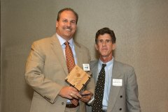 2014 Sunrise Breakfast - Bob Daino, left, accepts WCNY's award from Michael Kalet, right.
