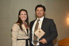 2014 Sunrise Breakfast - David Katleski, right, accepts Empire Brewing Company's award from Lyndsay Quiggle, left.