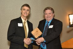 2014 Sunrise Breakfast - Peter King, left, accepts King + King's award from Jim Blair, right.